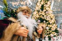 Happy Santa on background of bokeh christmas tree.