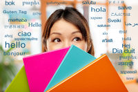asian woman or student hiding behind notebooks