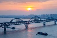 jiujiang yangtze river bridge closeup in sunset