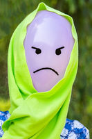 Balloon with angry face and green shawl