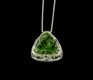White Gold Necklace With Peridot And Diamonds On Black Background