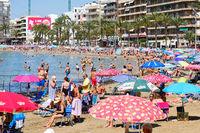 Torrevieja, Spain - June 10, 2019: Lot of people sunbath on Playa del cura beach of Torrevieja city. Spain