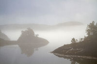 Misty mood on the fjord Fjaerangen