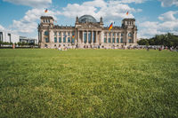 Meadow in front of the Reichstag building ( the German Bundestag ) in Berlin ,Germany