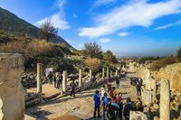 Tourists walking along Curete Street in the ruins of Ephesus city