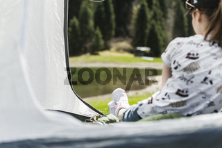 The girl in tent on vacation