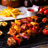 Rustic shish kebab skewers with marinated ham meat paprika and red onion
