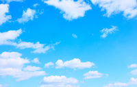 Light blue sky with white clouds -  background