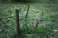 Three iron pipes in the grass
