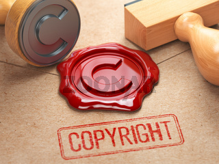Copyright rubber stamp  and sealing wax stamrp on the craft peper.  Intellectual property and copyright concept.