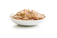 Whole grain mustard in bowl.