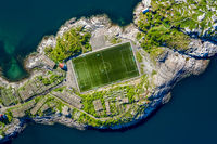 Football field stadium in Henningsvaer from above.