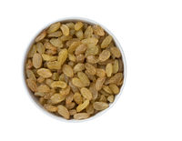 Heap of Yellow Raisins in Round Bowl Isolated on White Background. Golden Dried Seedless Grapes Top