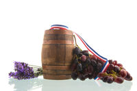 Wine barrel and red grapes