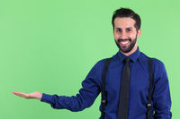 Young happy bearded Persian businessman showing something
