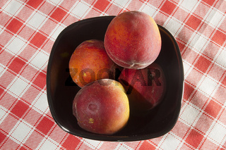 Peaches in ceramic ware