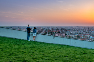 Couple wathing the sunset in Oradea from Mushroom Hill in Romania