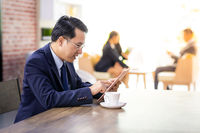 Businessman working in cafe
