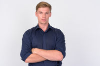 Young handsome blonde businessman with arms crossed