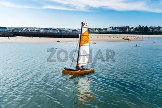 Catamaran sailing in the port of Morgat