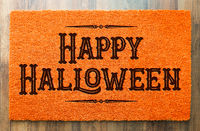 Happy Halloween Orange Welcome Mat On Wood Floor Background