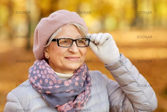 portrait of happy senior woman at autumn park