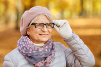 portrait of happy senior woman at autumn park