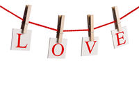 Pegs and word LOVE on rope