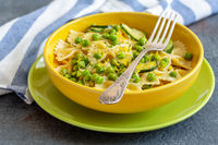 Pasta with zucchini and green peas.
