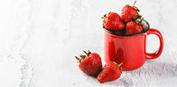 Fresh Strawberries in red cup