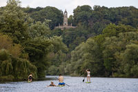 Stand up Paddling on the Ruhr in front of Berger monument, Witten, Ruhr area, Germany, Europe