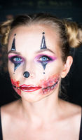 Woman with clown Halloween makeup