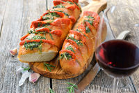 Roasted herb baguette with a glass of tempranillo