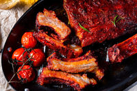 Grilled ribs in spicy marinade with salad and vegetables