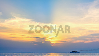 Travel boat on the sea at sunset