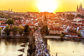 Panoramic view on Charles bridge and Prague sights at sunset