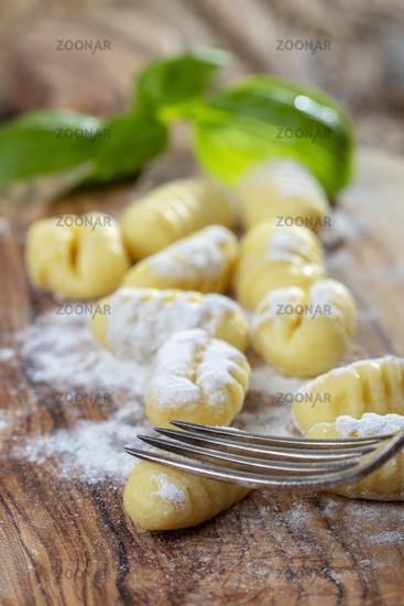 Close-up of raw gnocchi on wood