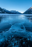 Sunset on a frozen lake in Kananaskis Country in the Canadian Rocky Mountains, Albeta