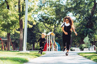 Mother and little son are walking in the park