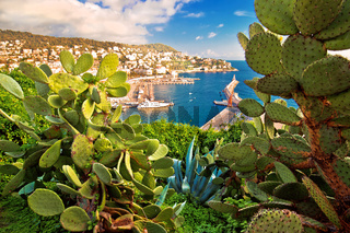 City of Nice colorful waterfront and yachting harbor view through mediterranean cactus and agave