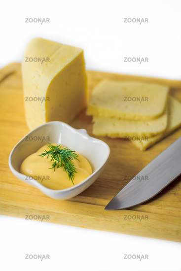 Cheese and cheese sauce on the board. Food and Drink. Milk products