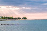 Sunbeams or sun rays at a sunrise on a beach in Sunny Beach on the Black Sea coast of Bulgaria