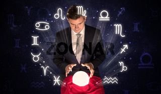 Astronaut looking for inspiration in his crystal magic ball