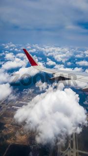 An airplane flying over Kuala Lumpur skies