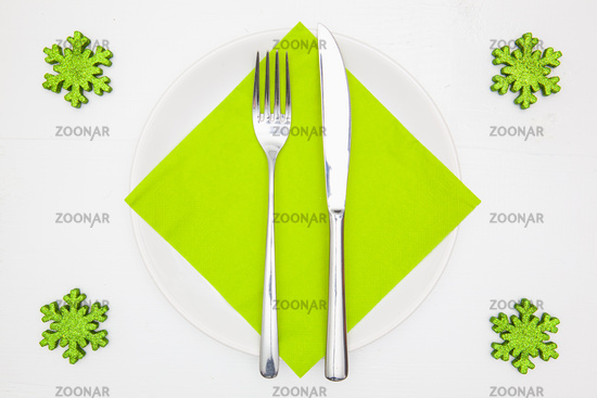 White square plate and green Christmas decoration