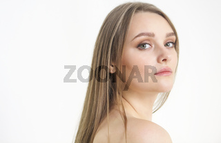 Beautiful plus size curly young blond woman posing on white
