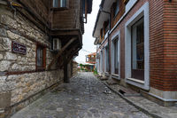 Beautiful and narrow street of the ancient seaside town. Deserted streets in the early morning.