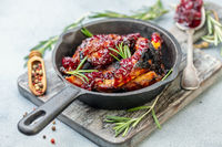 Ribs in honey glaze with cherry sauce and rosemary.