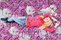 A woman between purple flower petals