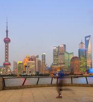 Jogging man, illuminated Shanghai cityscape
